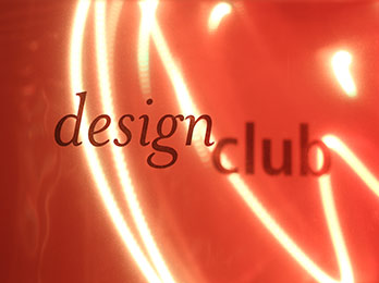Photo of Design Club text with orange lights in background