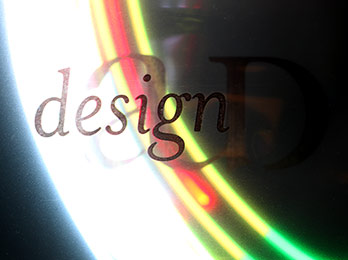 Photo of AU Design logo with white, red, yellow, and green streaks of light from upper left to lower right