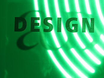 Photo of the word Design with array of green lights in background